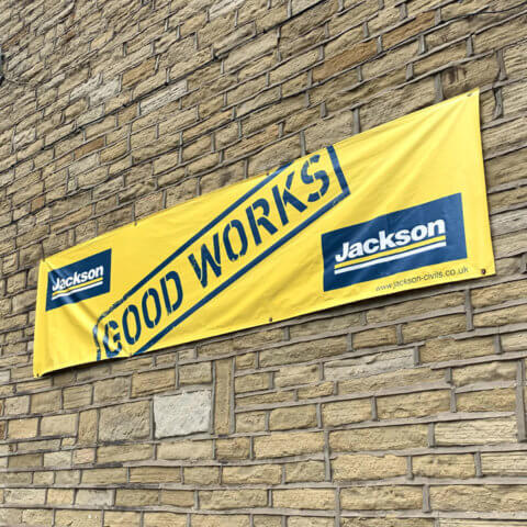 Outdoor banner on stone wall