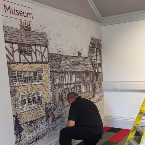 WallTex graphic being fitted on Bankfield Museum wall