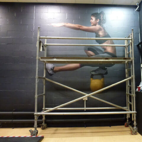 Fitting of Wall Guard High performance wear graphic at Leeds University