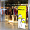 banner stand in shopping centre with wear face masks message